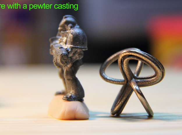 1 Inch Cut Mobius 3d printed The pewter casting has a seam, the 3D print does not..