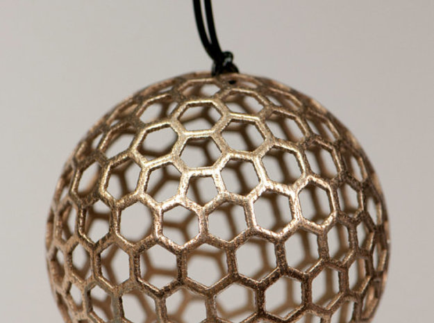 honeycomb sphere - 60 mm 3d printed Print in Stainless Steel as a pendant
