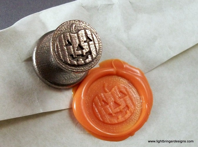 Jack-O-Lantern wax seal with impression in Mandarin Orange wax