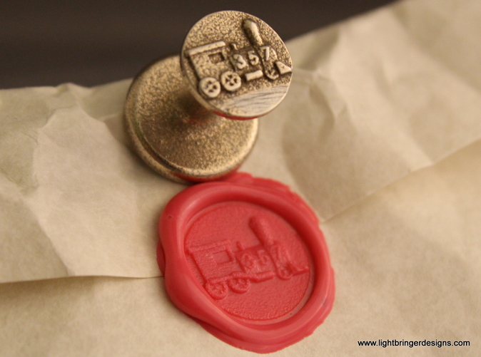 Locomotive wax seal with impression in Plumeria Pink sealing wax