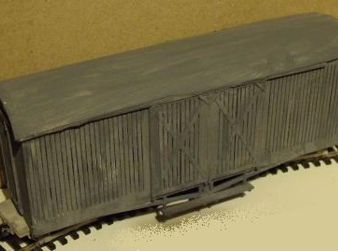 photo shows earlier version of model, roof now included, planking extended