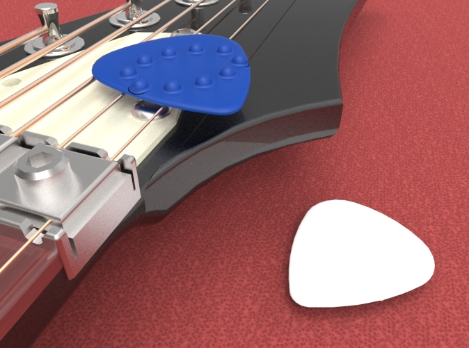 Guitar pick with Dimples on one side