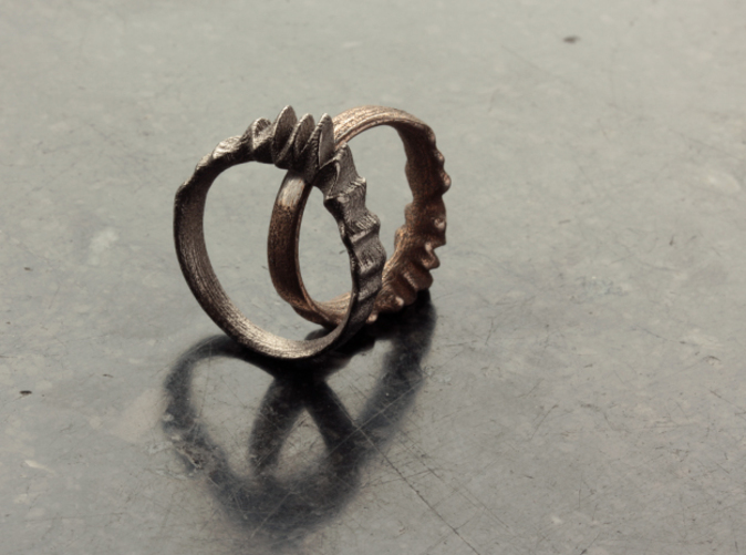 Ring on the left is in Polished Nickel Steel and the one on the right is in Stainless Steel