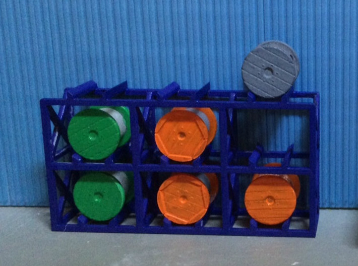 N 9x Cable Reel Medium 3d printed 6 painted cable reels on a storage rack