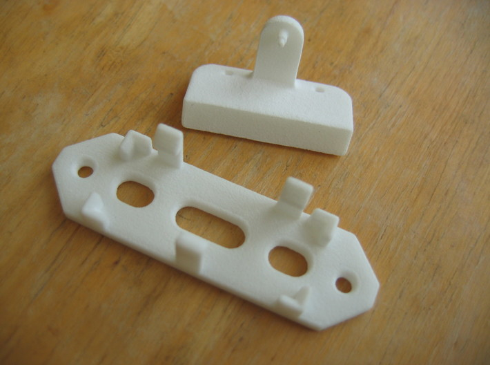Railroad switch / point actuator for PECO PL-13 3d printed The two parts before assembly.