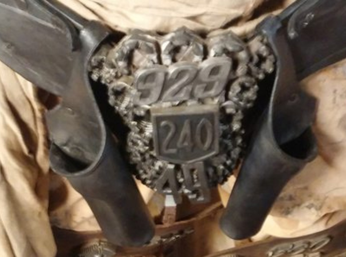 "Immortan Joe ""240"" Codpiece Badge / Emblem 3d printed A photo reference of the screen-used parts for comparison."