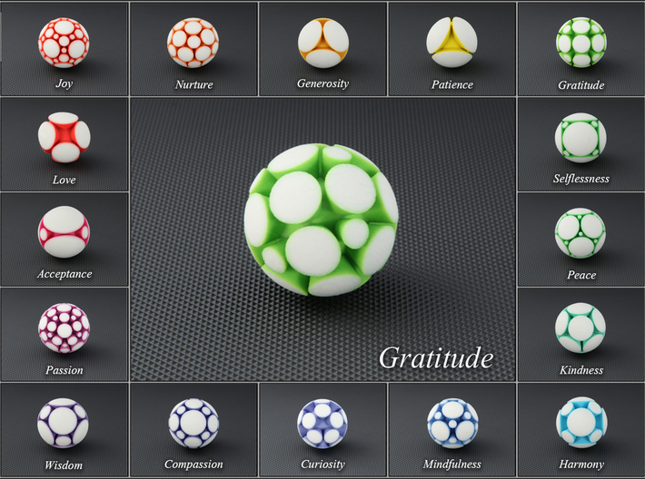 LuminOrb 2.7 - GRATITUDE 3d printed Photograph of GRATITUDE in Full Color Sandstone among LuminOrb Series I and II