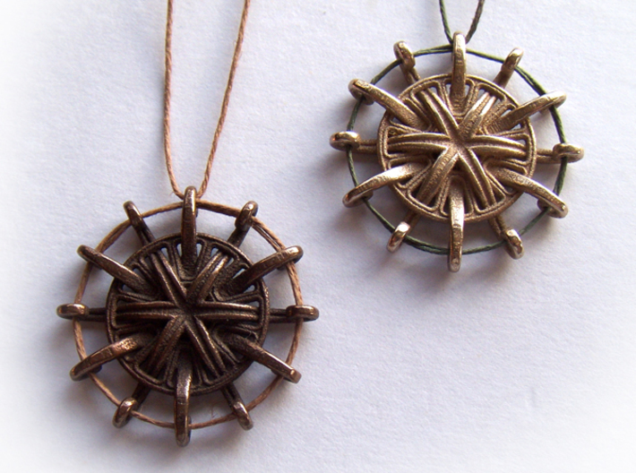 Tentacle Rosette Pendant 3d printed In stainless steel and antique bronze glossy.