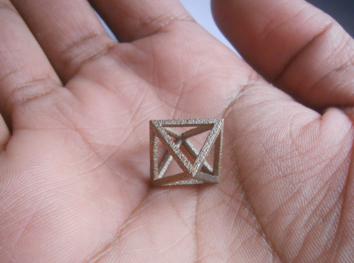 Faceted Minimal Octahedron Frame Pendant Small 3d printed Octahedron, held in palm of hand.