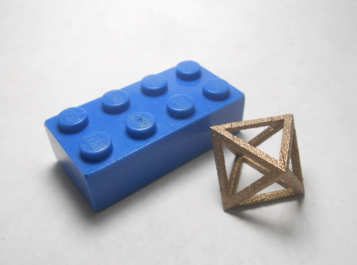 Faceted Minimal Octahedron Frame Pendant Small 3d printed Brick scale.