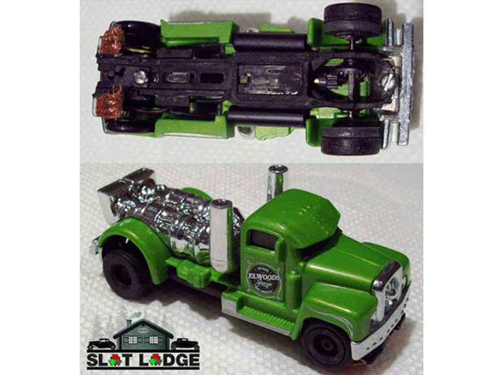Original SL1 - Narrow: HO Slot Car Chassis 3d printed SL1, painted black, under a 1/64 scale toy truck.