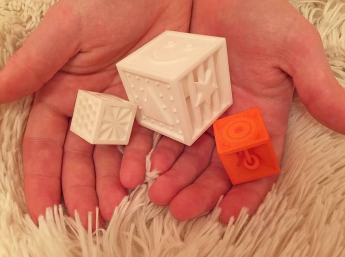 Pyramid Cube Tactile Dice 3d printed a photo comparing 3 of our dice...