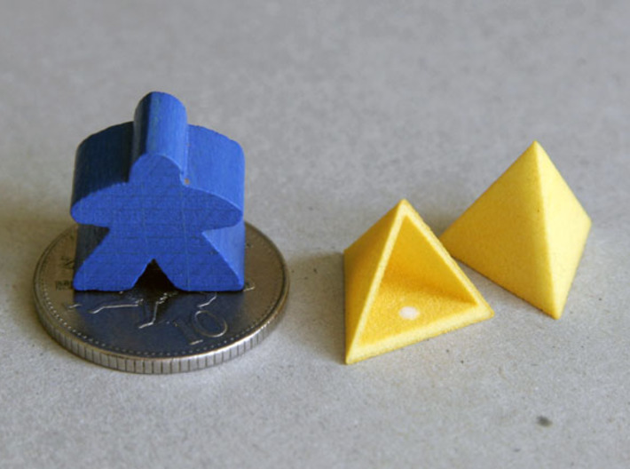 Tetrahedron Capstones (x20) 3d printed Showing scale with ten pence coin and meeple. Also shows the sprue cut-off point inside the capstone.