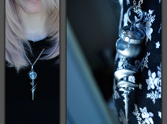 Serah Ferron Necklace 3d printed Sprayed vigorously with chrome spray paint and with added rhinestones.