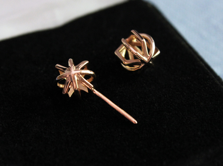 Hollow Orb Studs 3d printed Product shown is printed in 14k Rose Gold Plated.