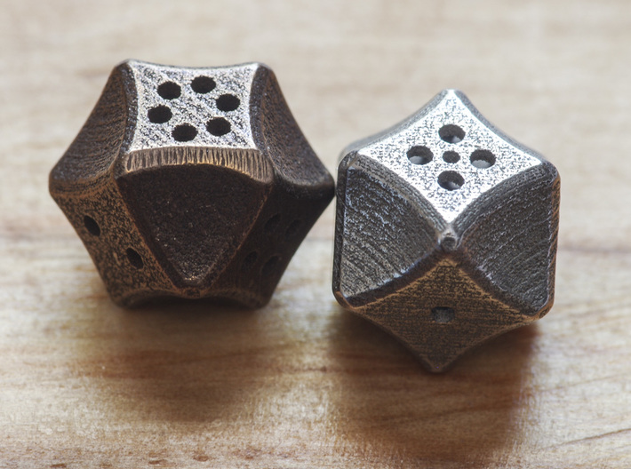 Futuristic Die 3d printed 2 of the dice printed: Left is Polished Bronze Steel and right is Stainless Steel.