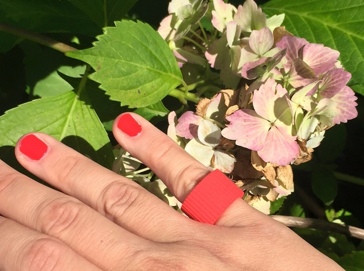 """Ingranaggi Band Ring 3d printed Red Strong & Flexible Plastic with a pale pinl """"ortensie"""" background"""