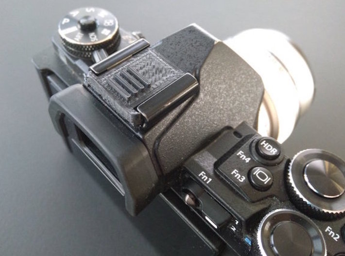 Hot Shoe Cover for Cameras 3d printed Printed at home (thus the horrible diagonal lines), showing proper size