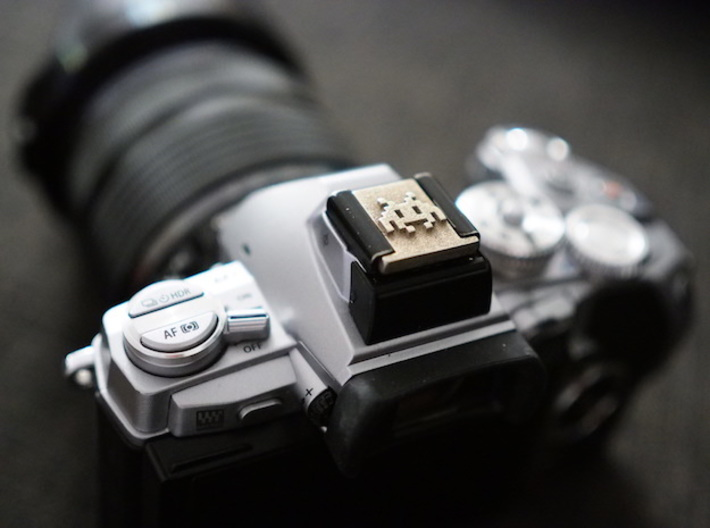 Hot Shoe Cover for Cameras, with Space Invaders 3d printed Perfect fit and great looks on a silver Olympus E-M1