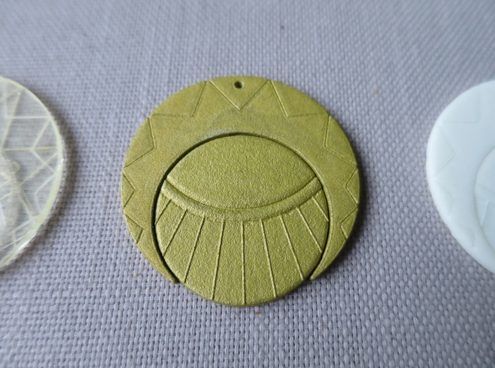 Estaban and Zia's Medallion from The Mysterious Ci 3d printed The back of the painted medallion.