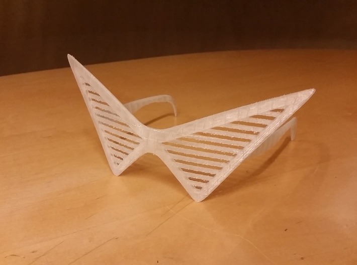 Triangle Glasses 3d printed 3D printed with PLA and supports. (Self Cleaned which is why it may look a little sharp in some places)