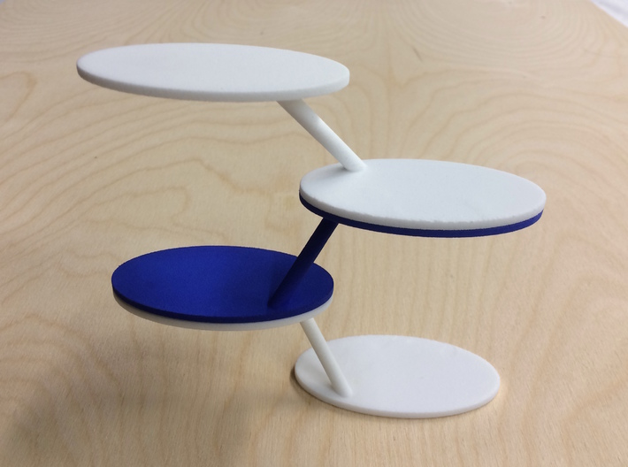 Wheel Walker 3d printed A stack of white and blue Wheel Walkers