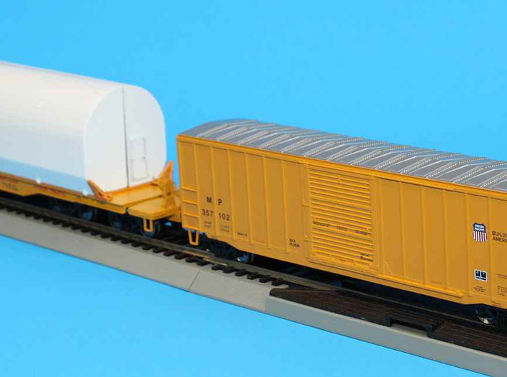 HO 1/87 NASA shuttle SRB clamshell brackets 3d printed A NASA SRB flatcar with a 'spacer' boxcar (Bachmann).