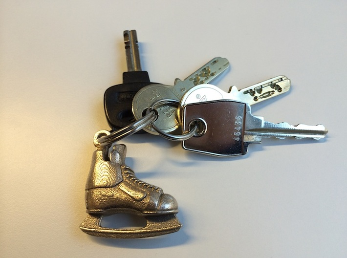 Keychain-Hockey-Skate 3d printed The Hockey Skate printed in Stainless Steel attached to a key chain.
