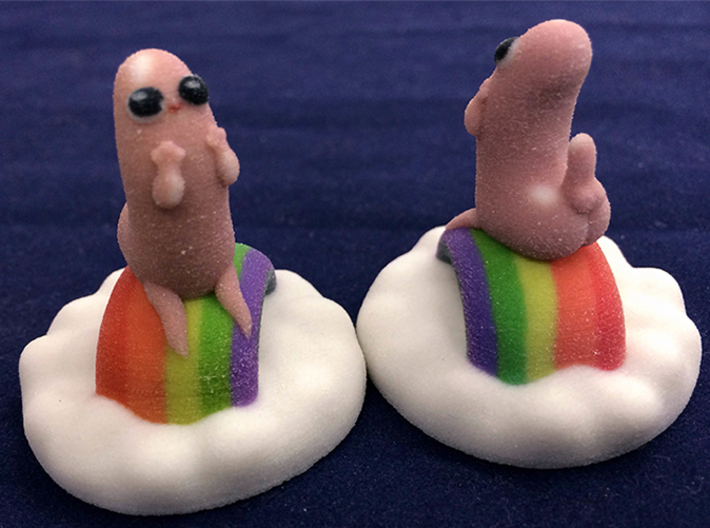 Dickbutt on a cloud of rainbows 3d printed Dickbutt printed in Full Color Sandstone