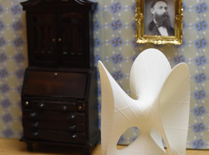 Clebsch Diagonal Surface, 27 lines, 119mm (4.7in) 3d printed The MO-Labs model in a dollhouse, with a portrait of Alfred Clebsch on the wall.