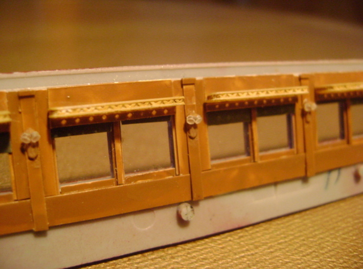 HO Pullman Parlor Car Luggage Racks Kit 3d printed HO luggage racks, painted and installed inside a Pullman car wall.