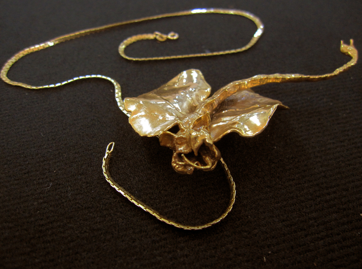 "Kat Dragon Pendant 3.25"" with large bail. 3d printed Foreshortened view of large,3.25"", Kat Dragon pendant printed in gold plate over solid brass. The chain is not included with the order."