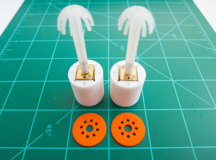 "Bussard Dome Assembly - 1:650 - For DLM Parts - 02 3d printed Two printed parts in ""Strong and Flexible"" orange polished plastic."
