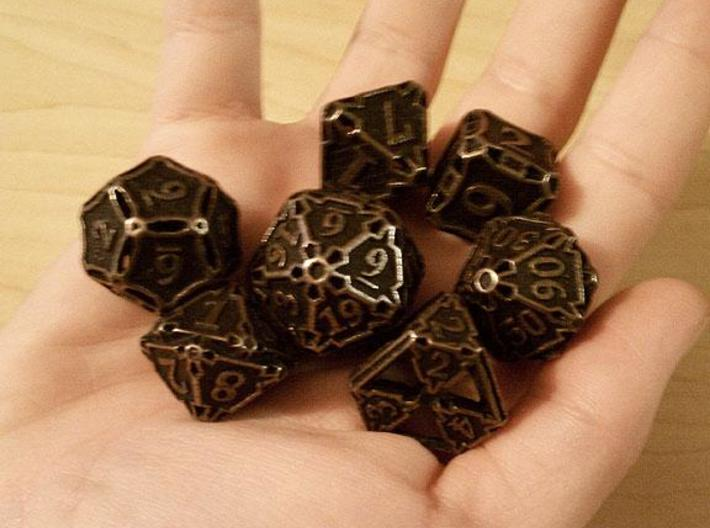Large Premier Dice Set 3d printed In antique bronze glossy and inked.