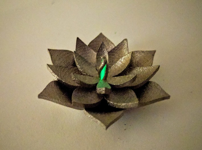Full Lotus 3d printed Low light capture of the assembly in polished nickel steel (default material).