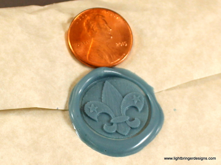 Fleur-de-lis Wax Seal 3d printed Fleur-de-lis impression in Light Blue sealing wax, with penny for scale.
