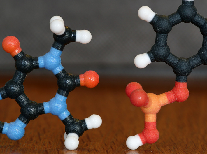 Benzene molecule model. 3 Sizes. 3d printed Coated (left) and non-Coated (right) Full Color Sandstone. Coating gives a much smoother feel.