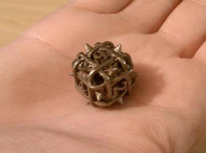 Thorn d6 3d printed In stainless steel.
