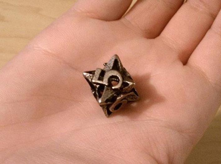 Pinwheel d6 3d printed In stainless steel and inked.