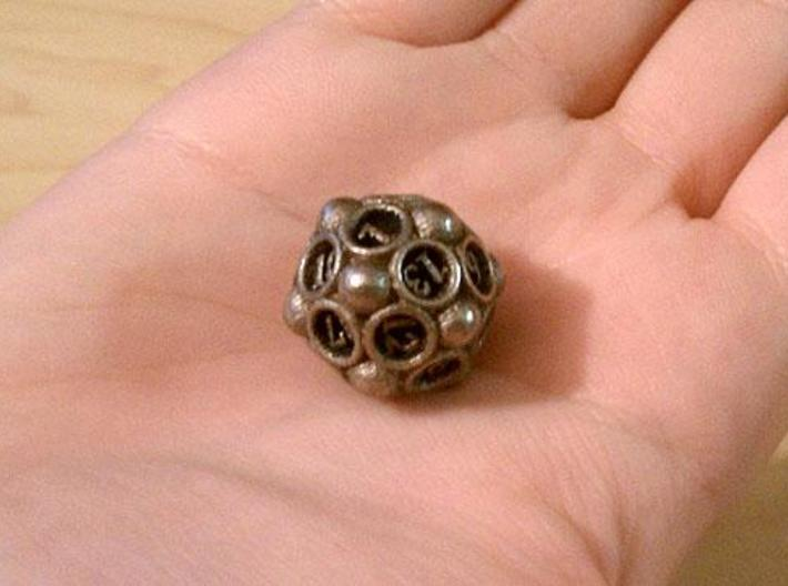 Spore Die20 3d printed In stainless steel and inked.