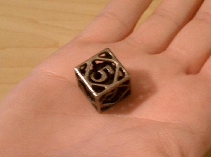 Cage d6 3d printed In stainless steel and inked.