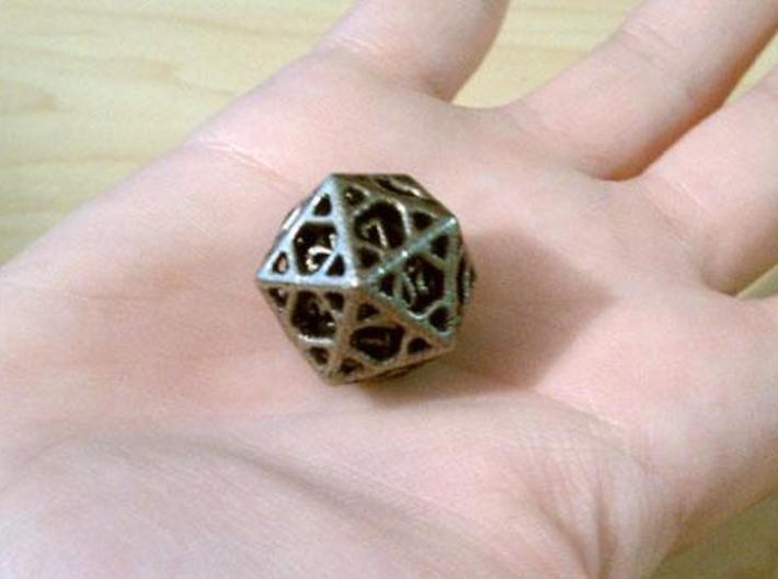 Cage d20 3d printed In stainless steel and inked.