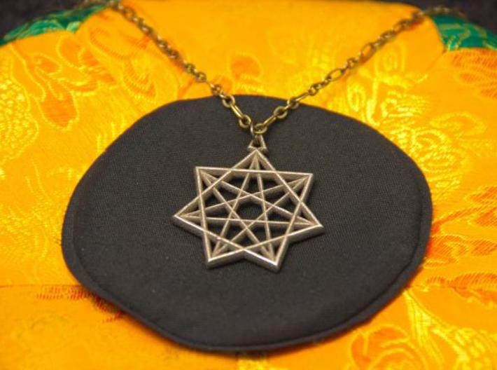 Double Heptagram Pendant 3d printed Photo of Stainless Steel pendant on a chain.