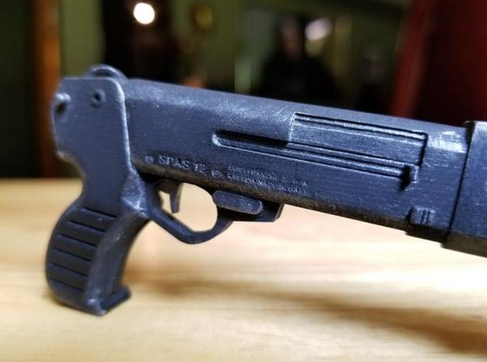 SPAS 12 1:6 scale shotgun with moveable pump 3d printed SPAS-12 model in frosted ultra detail, hand painted.  Size shown is 1:4 scale.