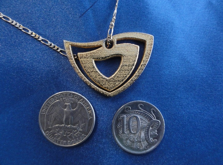 Abstract Heart Pendant 3d printed Pendant next to U.S. Quarter and Australian 10c coins