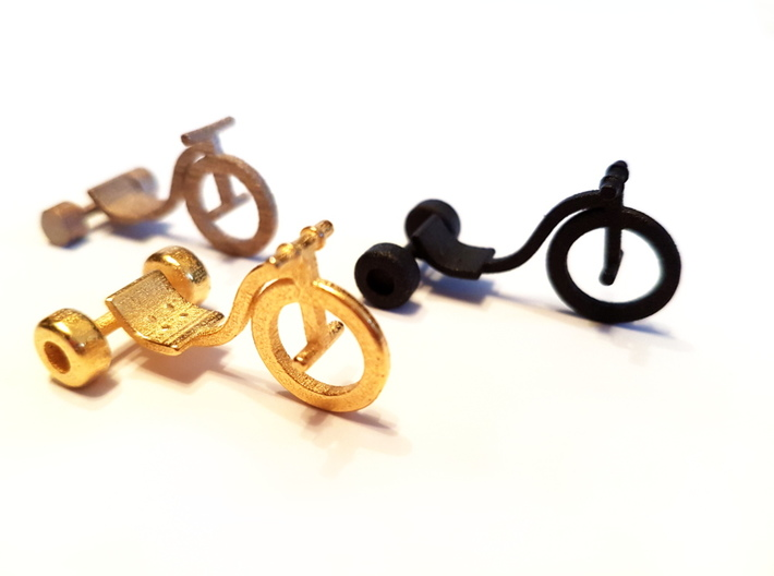 Drift Trike Pendant 3d printed Left to right: Stainless Steel, Polished Gold Steel, Matte Black Steel