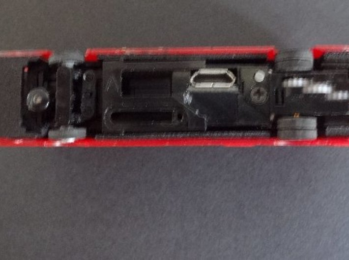 Interface for Tomytec chassis with New Routemaster 3d printed Underside of chassis in interface in a bus