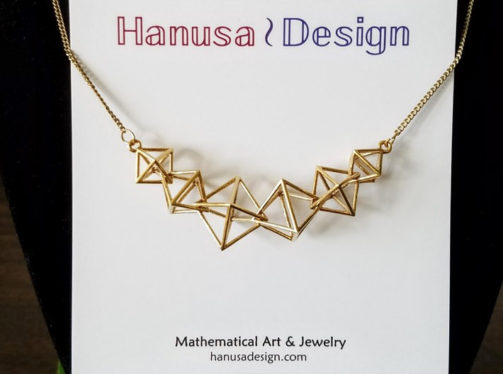 Interlocking Octahedron Necklace 3d printed Interlocking Octahedron Necklace in Raw Brass