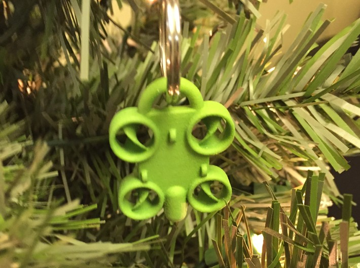 Minature Drone Ornament 3d printed Green Keychain shown being used as a Christmas tree ornament.  Key ring not included with purchase.