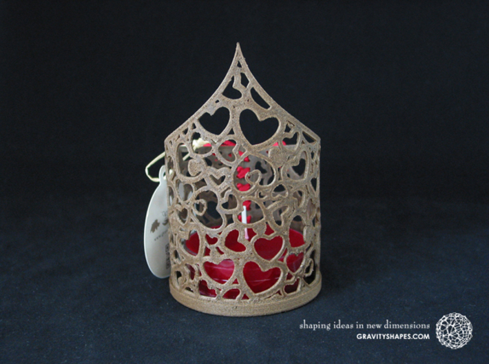 Pointed tealight holder with hearts 3d printed The photo shows an own print (FDM print) made of brown wood incl. decorative lacing.